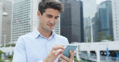 Hispanic businessman use of cellphone