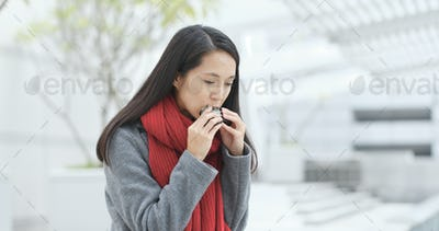 Woman eating japanese rice cake