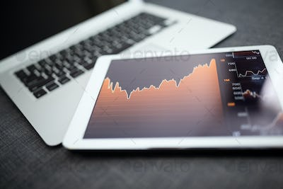 Analyzing stock market from digital tablet