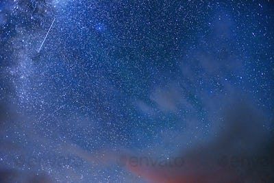 fantastic meteor shower and the snow-capped mountains