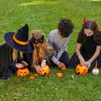 Group of Kids Playing Outdoors on Halloween