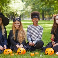 Group of Kids Wearing Halloween Costumes Outdoors