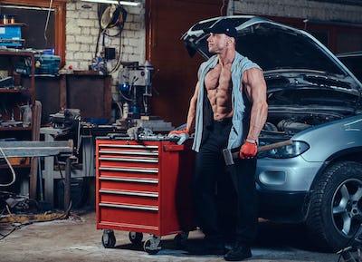 A man in a garage.