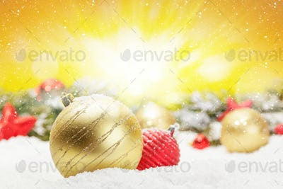 Christmas greeting card with decor in snow