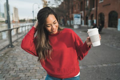 Young woman holding a cup of coffee.