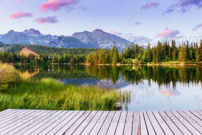 The sunrise over a lake in the park High Tatras. Shtrbske Pleso,