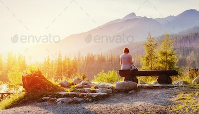 Girl on a bench at sunset