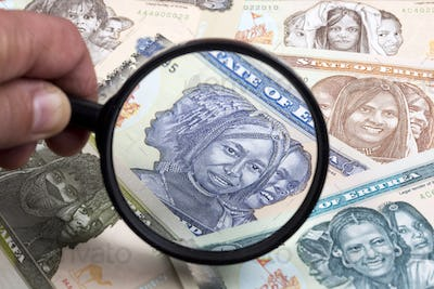 Eritrean money in a magnifying glass