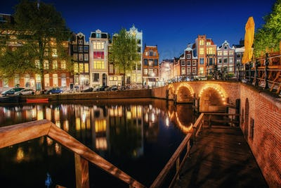 Canal in Amsterdam at night. Highlighting buildings and streets