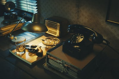Film noir detective desktop with revolver