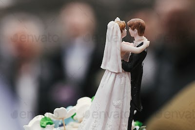 stylish classic wedding cake topper of bride and groom dancing