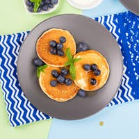 Pancakes served with fresh blueberries. Spring