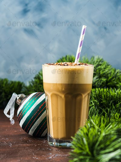Frappe coffee in tall glass on brown. New year