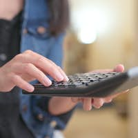 Woman use of calculator
