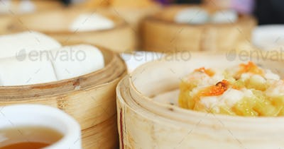 Eating steamed chinese dim sum in restaurant