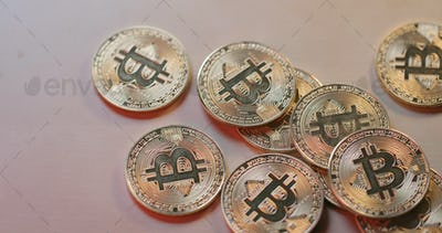 Heap of bitcoin on table