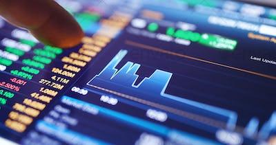 Digital tablet display the stock market data