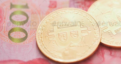 Chinese banknote and Bitcoin
