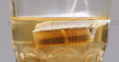 Putting tea bag into hot water