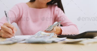 Housewife counting the money for daily expenditure