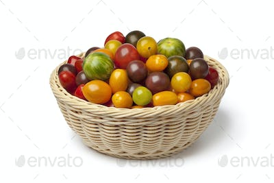 Basket with different color organic tomatoes