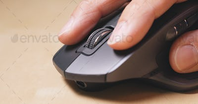 Man use of computer mouse on table