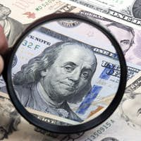 American dollars in a magnifying glass