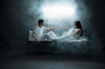 Crazy man and woman are sitting in bed, insomnia