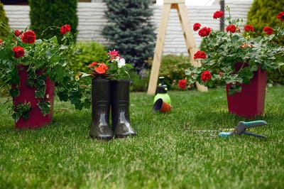 Gardening tools and rubber boots, nobody