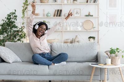 Music Fun. Excited Woman Listening Favorite Songs In Wireless Headphones At Home
