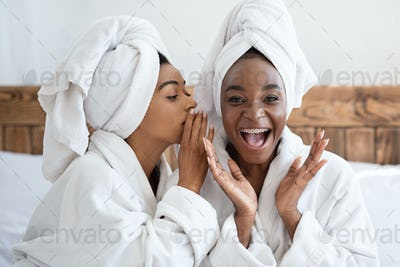 Pretty african women having girlish day at home