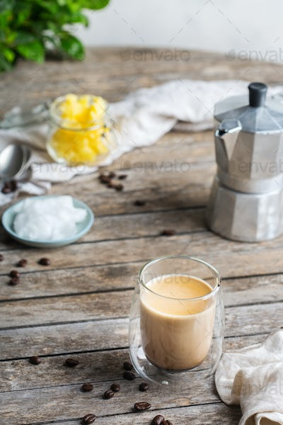 Keto, ketogenic bulletproof coffee with coconut oil and ghee butter