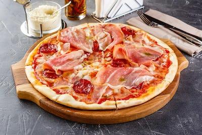 Pizza with salami and prosciutto