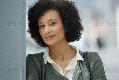 attractive older african american woman looking at camera