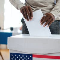 Unrecognizable african-american man putting his vote in the ballot box, usa elections and