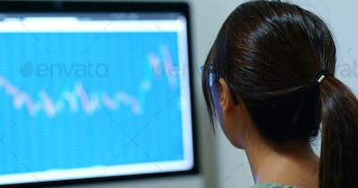 Woman study on the stock market data in office