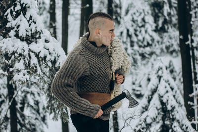 Viking warrior with mohawk haircut and wolf pelt armor holding axe