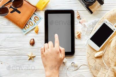 Empty tablet, card, camer,a  sunglasses, compass, passport, money, phone, hat