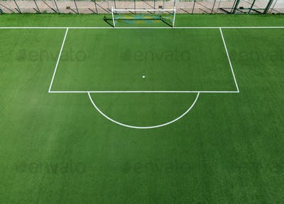 Aerial view of an empty green soccer field