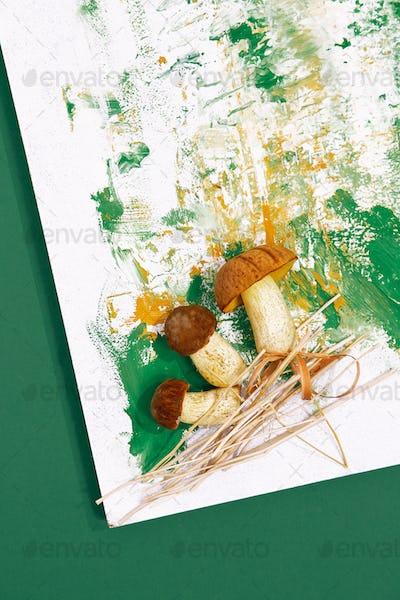 Fresh mushrooms on design painted background. Minimal art. Autumn concept