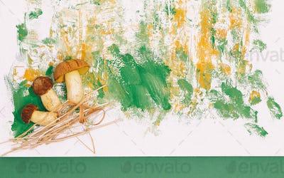 Fresh mushrooms on design painted background. Minimal art. Autumn concept. Copy space