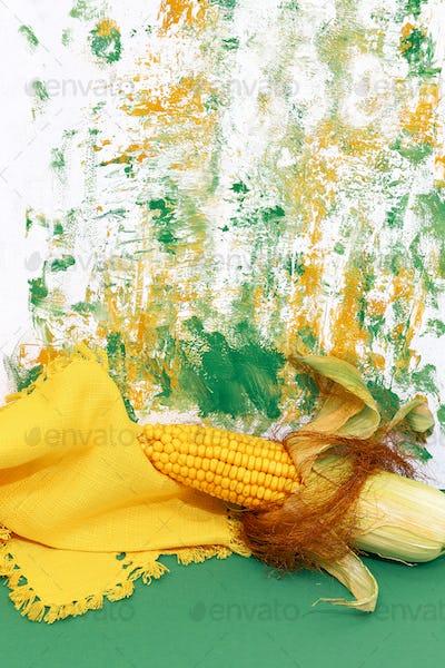 Fresh corn on design painted background. Minimal art. Autumn eco bio life concept