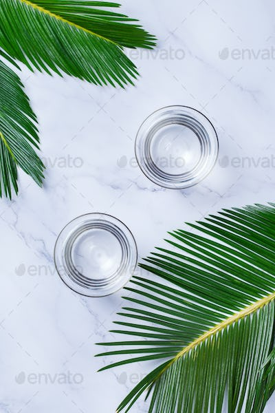 Glasses of water on a trendy marble background