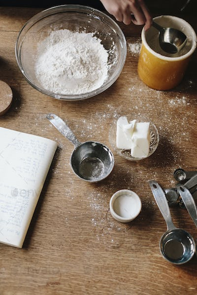 Overview of a kitchen table with ingredients for baking