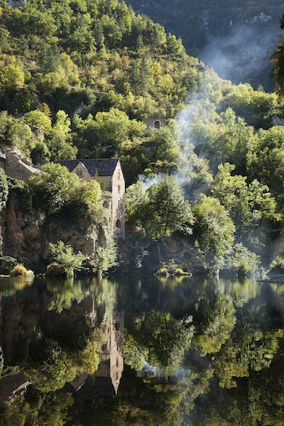 Woodland, and a thin stream of rising woodsmoke, elevated view of river