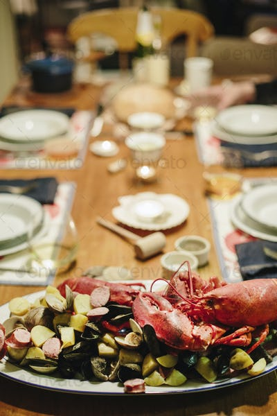 A table laid for a meal, a seafood platter with lobster and clams.