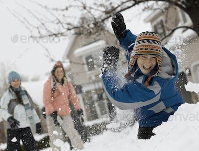 Winter snow. Three children having a snowball fight.