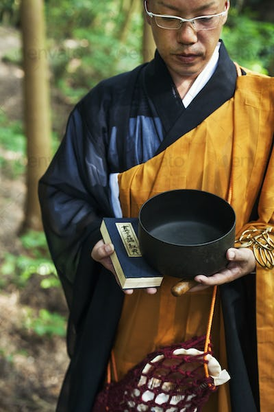 Buddhist monk carrying an alms bowl