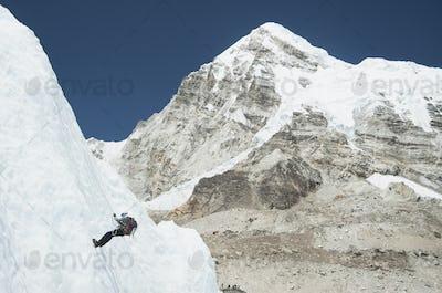 Climber using rope on mountain, Everest, Khumbu region, Nepal