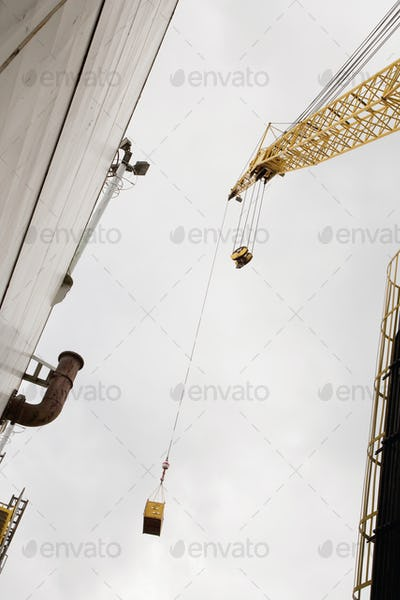 Industrial Crane view from below, moving cargo